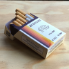 Side angle view of a pack of CBD cigarettes with an opened pack to show 20 CBD cigarettes