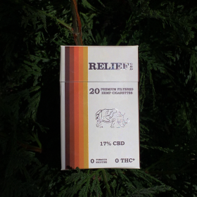 20 Pack of Relief CBD Cigarettes sitting on a tree in a forrest